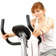 Woman on stationary training bicycle — Stock Photo