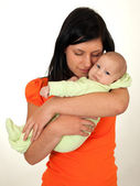 Mother hugging her newborn boy — Stock Photo