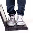 Stock Photo: One person standing on laptop
