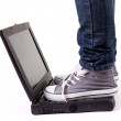 One person standing on laptop — Stockfoto