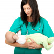 Woman doctor keeping baby boy — Stock Photo #4000786