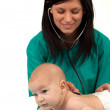 Stock Photo: Woman doctor exams baby