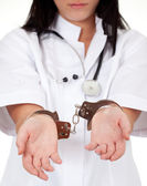 Female doctor in handcuffs — Stock Photo