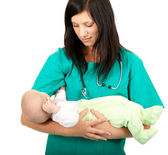 Woman doctor keeping baby boy — Stock Photo