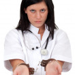 Female doctor in handcuffs - Stock Photo