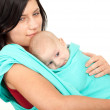 Mother carrying baby in scarf — Stock Photo