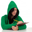 Serious woman writing on clipboard — Stock Photo #4050786