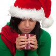 Woman in christmas hat with red cup — Stock Photo #4050830