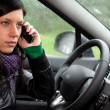 Royalty-Free Stock Photo: Speaks by phone woman in car