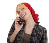 Smoking woman speaks by phone — Stock Photo