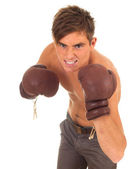 Angry man in boxing gloves — Stock Photo