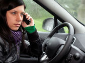Speaks by phone woman in car — Stock Photo