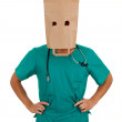 Doctor with paper bag on head — Stockfoto