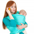 Phoning mother with baby boy in sling — Stock Photo