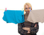 Young woman washing hangs on clothesline — Stock Photo