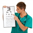 Doctor with optometry chart — 图库照片