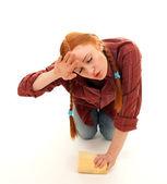 Tired woman washing floor — Stock Photo