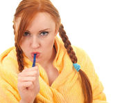 Young woman and toothbrush — Stock Photo
