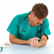 Drug addict doctor in action - Stock Photo