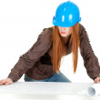 Female architect reading blueprints — Stock Photo