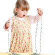 Little girl with chains — Stock Photo