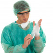 Doctor pulling on surgical gloves — Stock Photo #4268488