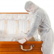 Exhumation - man with coffin - Stock Photo