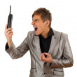 Screaming man and phone - Stock Photo