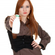 Young woman with white bottle — Stock Photo