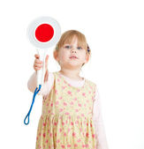 Little girl keeping stopping sign — Stock Photo