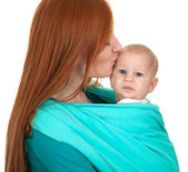 Baby wrapped up in mother's blue scarf — Stock Photo