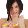 Stock Photo: Young woman with toothbrush
