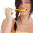 Young woman with toothbrush — Stockfoto