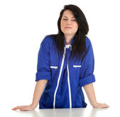 Young woman in blue coveralls — Stock Photo