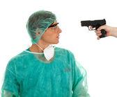 Doctor and gun — Stock Photo