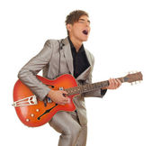 Man playing on electric guitar — Stockfoto
