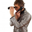 Calling spy man using binoculars — Stock Photo #4406340