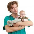 Male doctor examining baby boy — Stock Photo #4406414