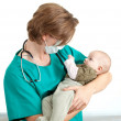 Male doctor examining baby boy — Stock Photo #4406441