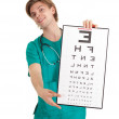 Doctor with optometry chart — Stok fotoğraf