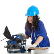 Woman with saw preparing for cutting — Stock Photo