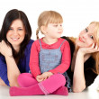 Little girl with two women — Stock Photo
