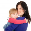 Little girl in mothers arms — Stock Photo