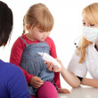 Female doctor examining little girl — Stock Photo