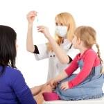 Female doctor examining little girl — Stock Photo