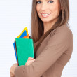 Stock Photo: Smiling student lady with note pads