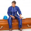 Drinking beer man sits on coffin — Stock Photo #4407207