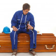 Smoking man sits on coffin with beer — Foto de Stock