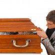 Stock Photo: Mwith coffin