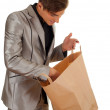 Young man keeping paper bag — Stock Photo #4407261